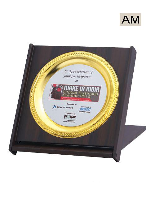 golden metal plate with wooden mementos